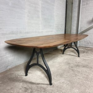Oval table with American black walnut top and cast iron base